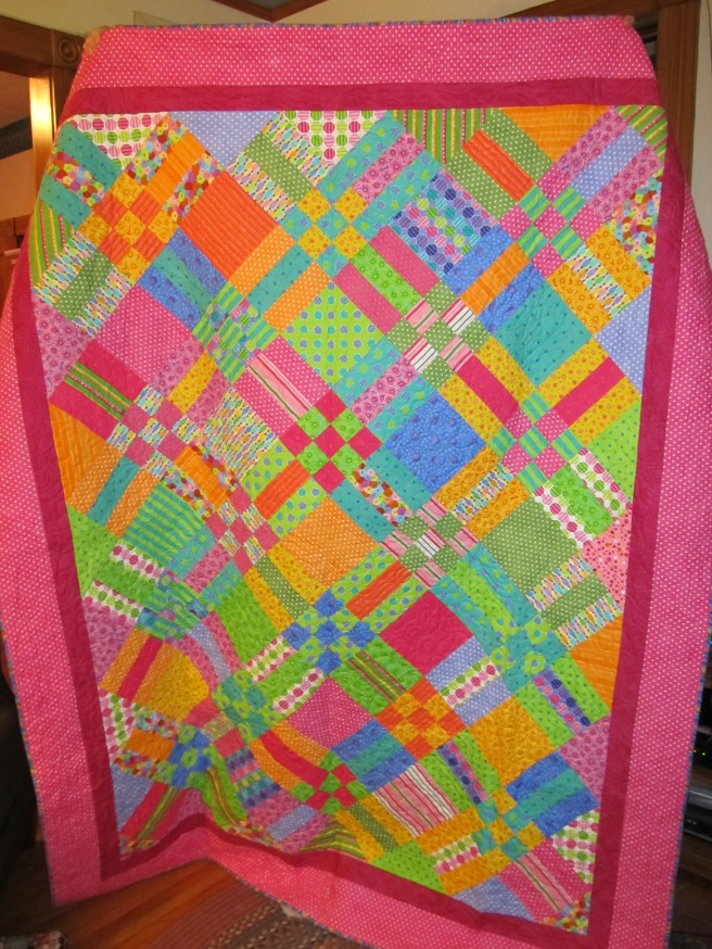My fuschia nine patch and rails quilt.