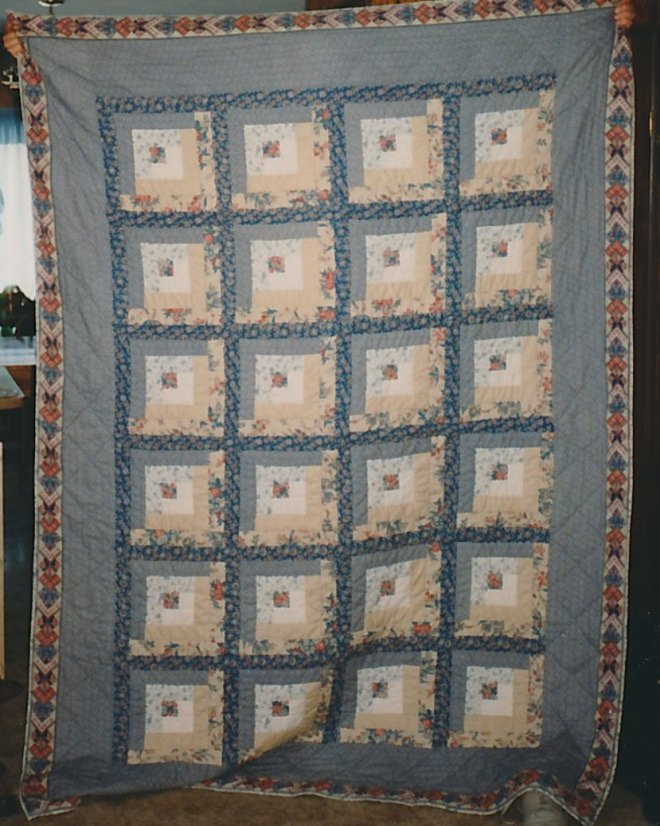 The blue and tan log cabin quilt.  My very first quilt!
