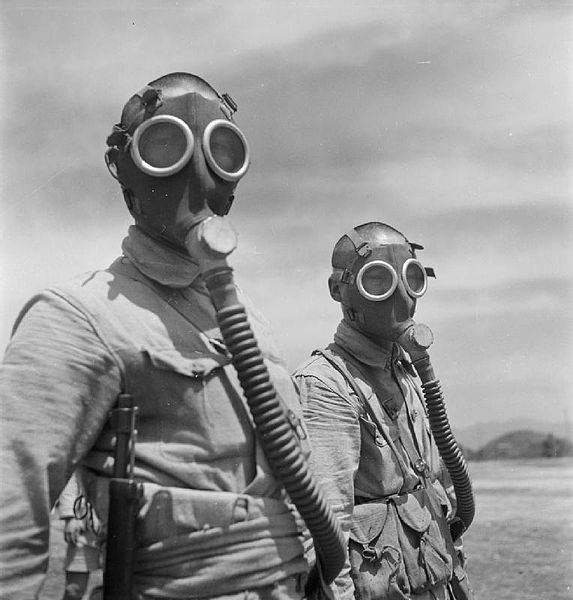China 1944: Two Chinese soldiers wearing gas masks at Pihu Military Training Centre in south eastern China.