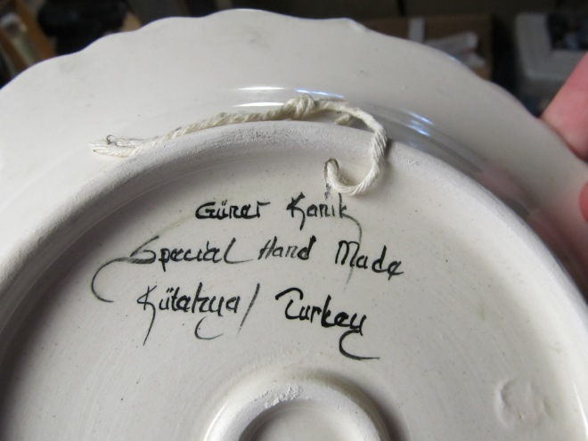 signature on the older plate