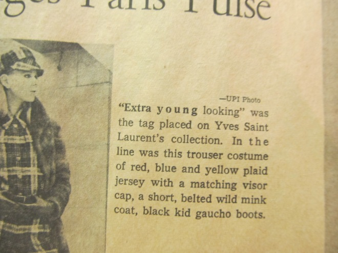 """Extra young looking"" was the tag placed on Yves St. Laurent's collection. In the line was the trouser costume of red, blue and yellow plaid jersey with a matching visor cap, a short, belted wild mink coat, black kid gaucho boots."