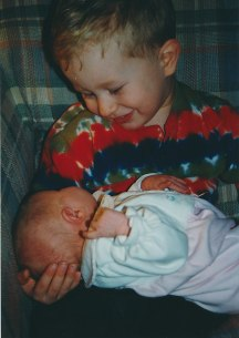 Brother gets to hold baby Sarah for the first time at home!