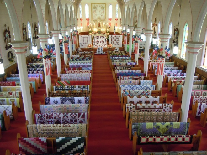 Three short years ago La Guilde Acadienne de Clare was formed and with a lot of hard work and dedication to the craft, the founding members decided to organize and host an annual quilt show and sale in the Sacred Heart Church. Image from  The Painted Quilt Blog.