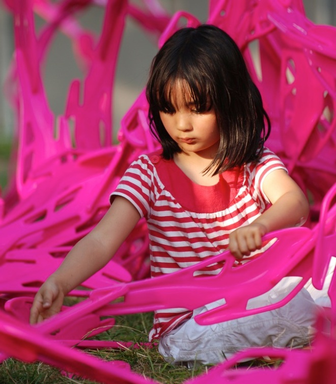 girl creating with BLOOM cells