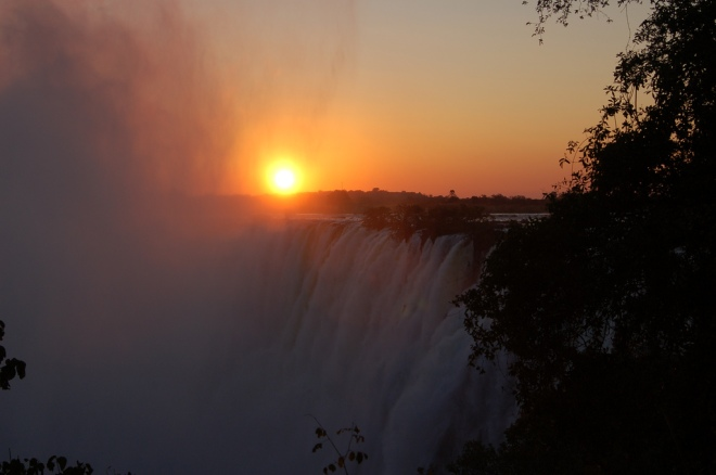 Victoria Falls in Zambia at sunset, by Ryan.  CC license via Flickr