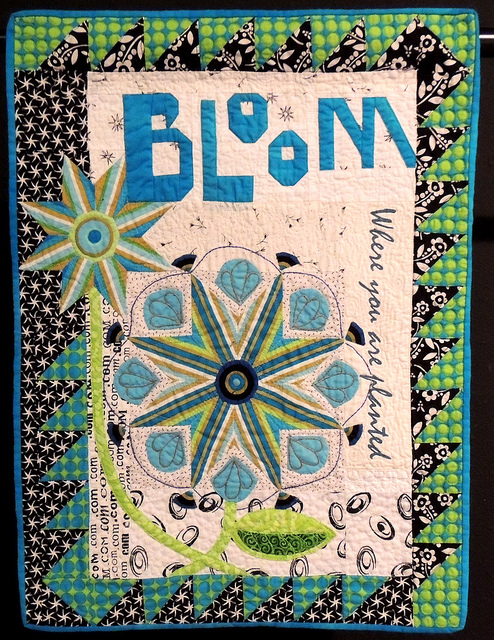 """Bloom where you are planted"" quilt.  Image by Sophie via Flickr CC."