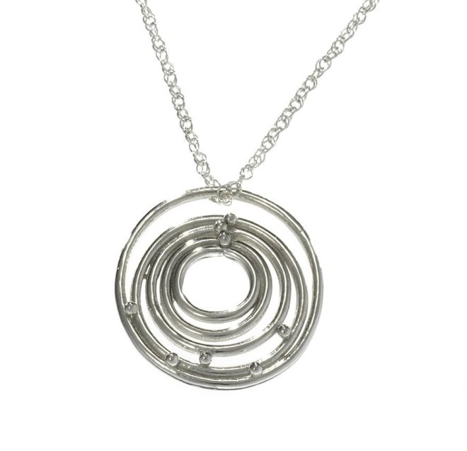 http://www.madebysurvivors.com/collections/necklaces/products/silver-circles-of-life-necklace