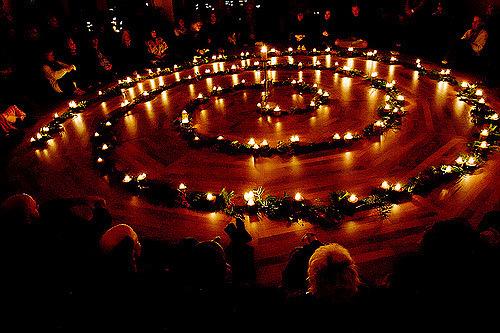 Doug Ellis via Flickr CC license candle light prayer circle