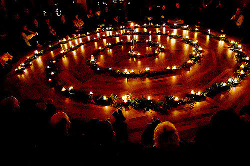Doug Ellis via Flickr CC license candle light prayer circle